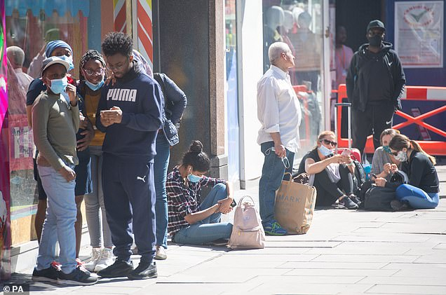 LONDON: Others sat on the floor outside a Sports Direct on Oxford Street as they waited to enter the store