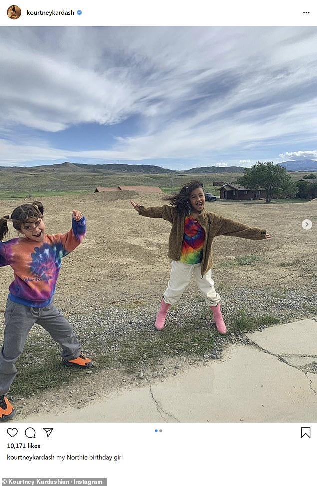 Birthday girl: Kourtney shared this picture on Monday of girl Penelope playing with North cousin - who just turned seven on the grounds of Kim and Kanye's $ 14 million ranch