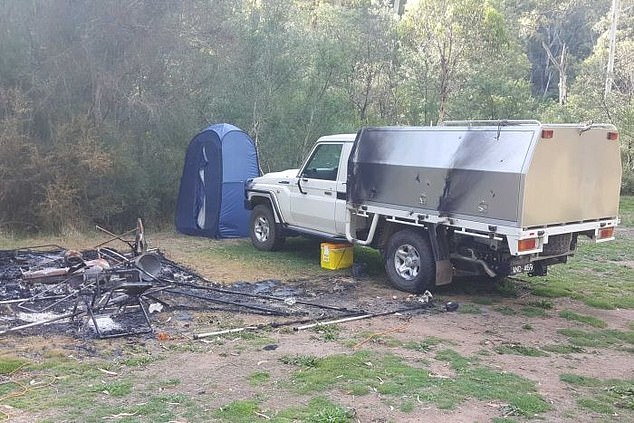 Mr Hill's white Toyota Landcruiser was found with minor fire damage at their burnt campsite (pictured) near Dry River Creek Track in the valley on March 21