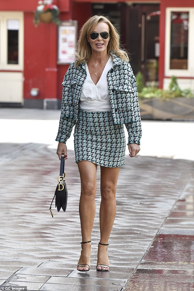 Leggy look: Amanda looked phenomenal in the sexy two-piece, because it has shown its age in style with the thigh skimming mini letting her legs steal the show