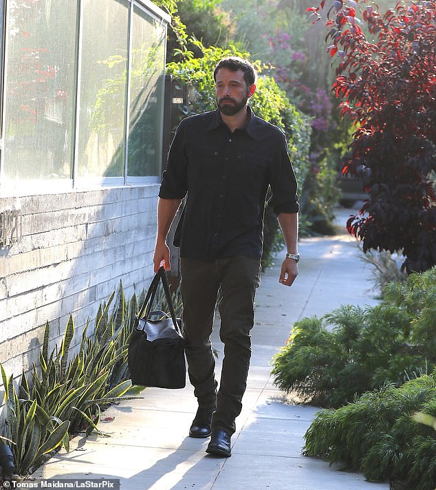 Arrival: Affleck was also spotted arriving Tuesday at Armas' home in Venice, California, carrying a black sports bag