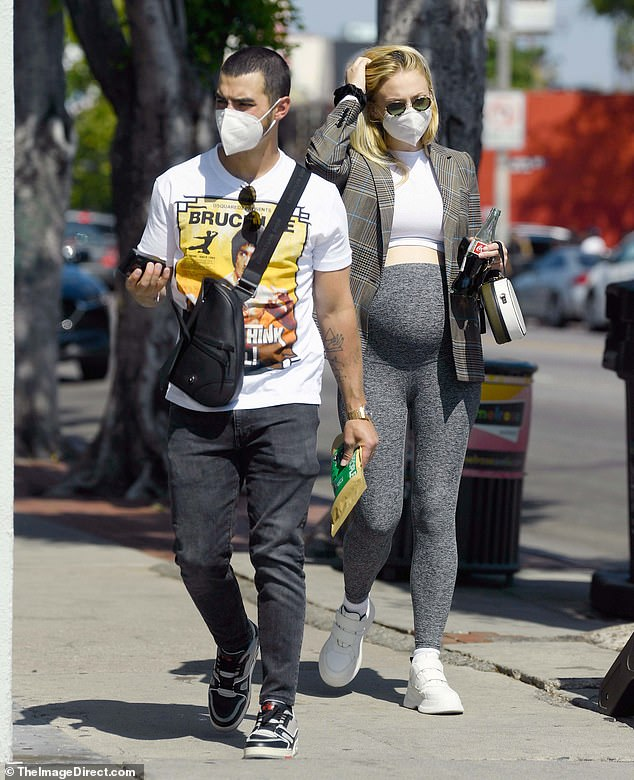 Beloved: she had her husband Joe Jonas by her side during the day and the pair wore masks for the outing
