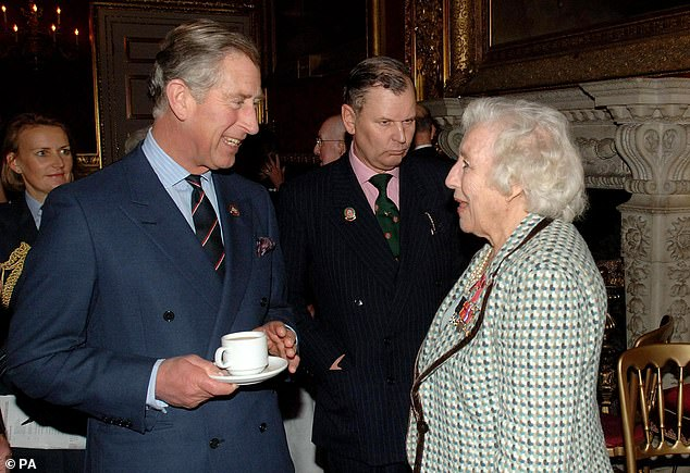 Dame Vera Lynn with Prince Charles attending a reception for the 'Not Forgotten Association' at St James's Palace in central London in December 2006