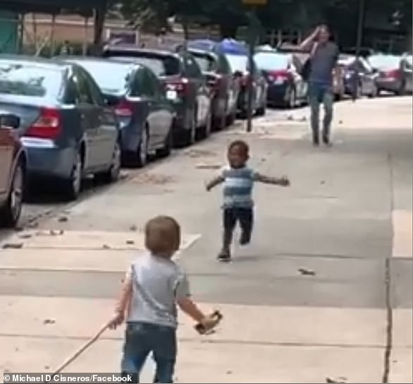 Toddlers Finnegan (left) and Maxwell (center), both aged two, raced towards each other with arms ready to embrace after they hadn't seen for two days