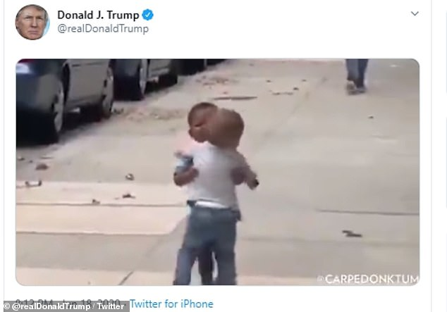 The two boys are seen embracing in the clip that the president shared on social media on Thursday