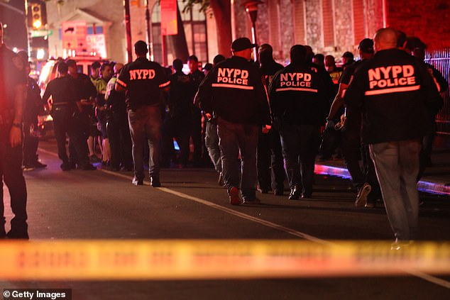 A report in The New York Post shows shootings are still surging into June. Police are gathered at the scene of shooting in Brooklyn on June 3, in which two officers were hit by gunfire