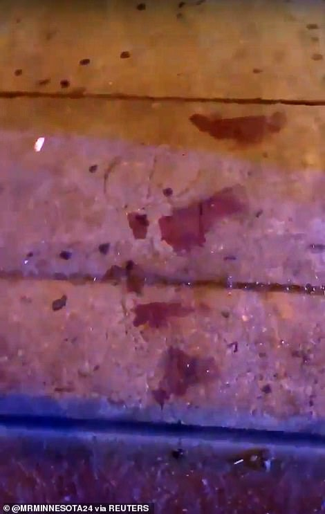 Blood is seen on the ground after the shooting