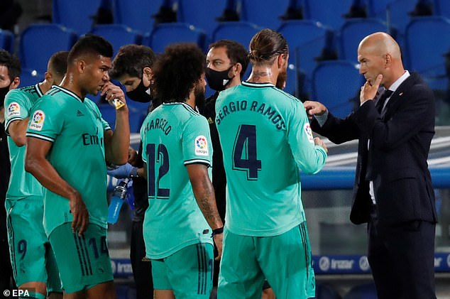 Zidane (right) was keen to talk about his team's performance rather than that of the referee
