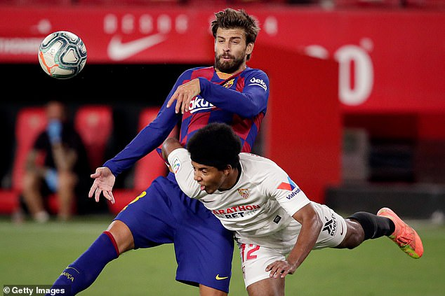Barca's Gerard Pique (top) had earlier suggested that Real Madrid were getting big decisions