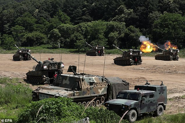 A self-propelled artillery unit conducts a firing drill at a training range in Paju, South Korea, near to the North Korea border