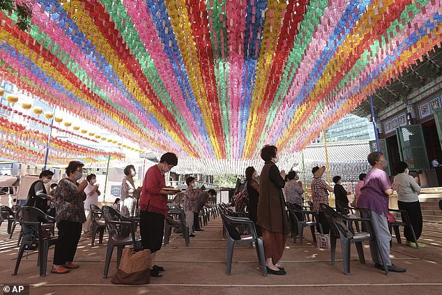 South Koreans pray during a service atthe Chogyesa temple in South Korea today