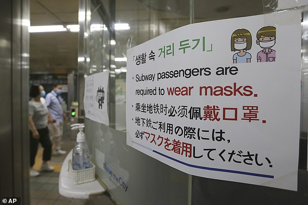 A notice on the precautions to be taken against the novel coronavirus is displayed at a subway station in South Korea today