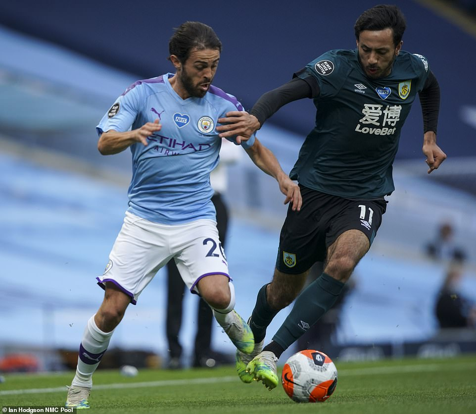 Bernardo Silva battles for the ball with Dwight McNeil during the first-half of the Premier League clash at the Etihad Stadium
