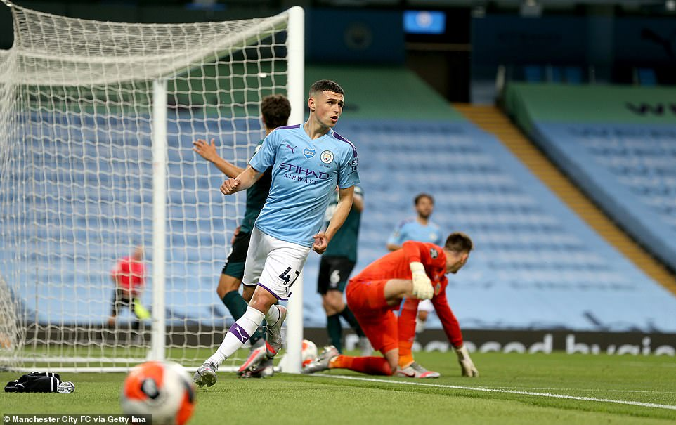 Foden dashes off after scoring his side's fifth goal in a brilliant performance from the 20-year-old English midfielder