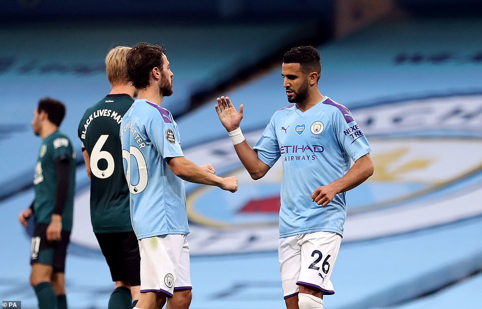 Bernardo Silva gives Mahrez a high five to celebrate the winger giving City a three-goal advantage in the first-half