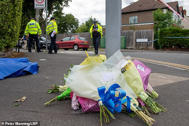 The flowers have been left at the scene where a man was shot in the head and died on Friday