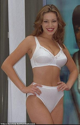 Pin-up: She's famed for her hourglass curves (pictured in 1997)