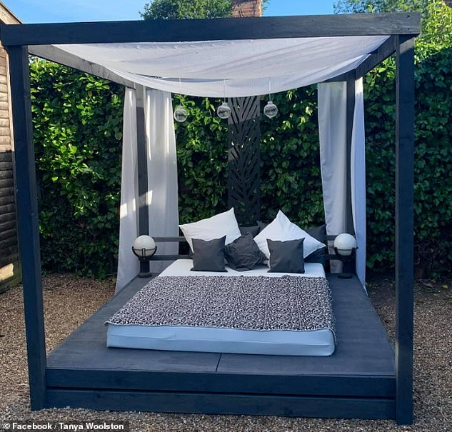 UK-based Tanya Woolston used old pallets, £70 in wood and material she already had lying around the house to create the private oasis in her mother's back garden, pictured