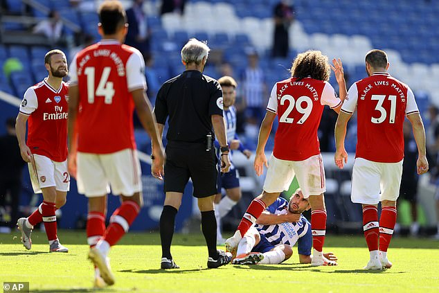Guendouzi (second from right) at the oar with the striker Neal Maupay as Arsenal lost 2-1 to Brighton