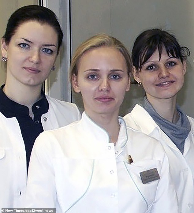 Maria, pictured centre, is believed to be married to a Dutch businessman with whom she has a family, making Putin a grandfather