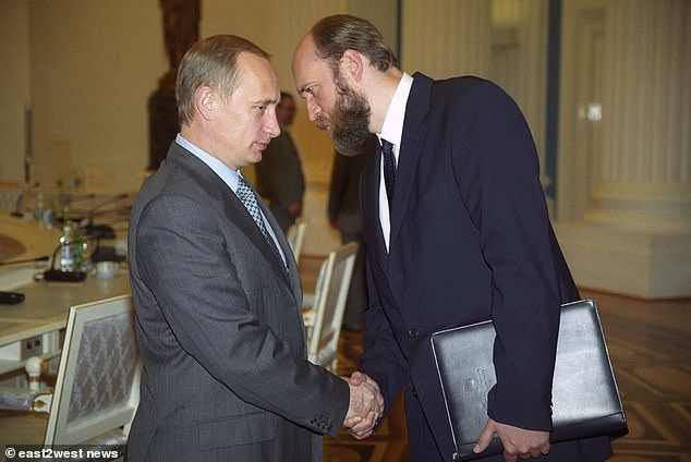 Sergei Pugachev (right) is pictured shaking hands with President Vladimir Putin shortly after he rose to power in the early 2000s