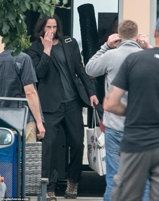Low Profile: Keanu was dressed casually when he arrived in Germany