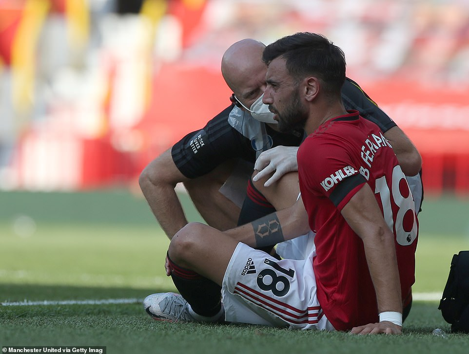 Bruno Fernandes receives treatment for an injury on the side of the pitch but was able to return to the game shortly after