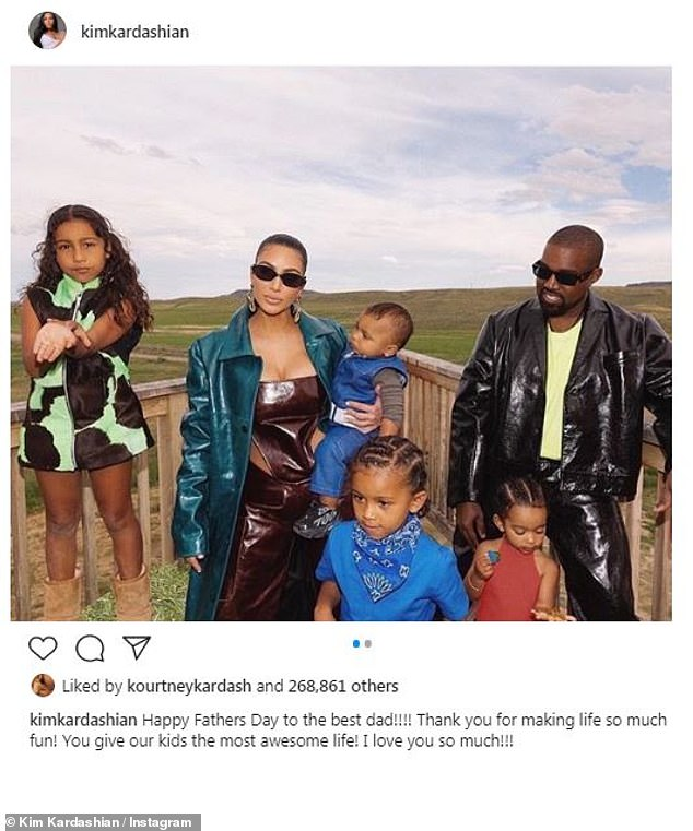 Family is everything:Kim shared a family snap on Sunday in honor of Father's Day as they posed at their ranch