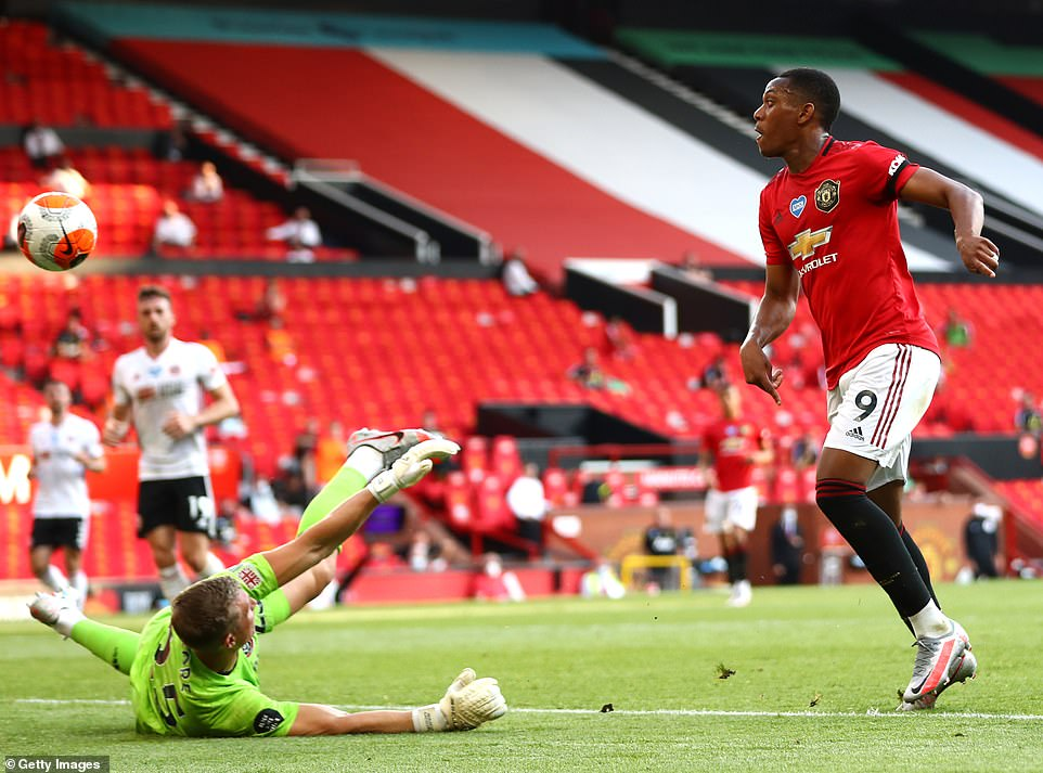 Martial chips the ball over Sheffield United goalkeeper Simon Moore to complete his hat-trick 15 minutes from time