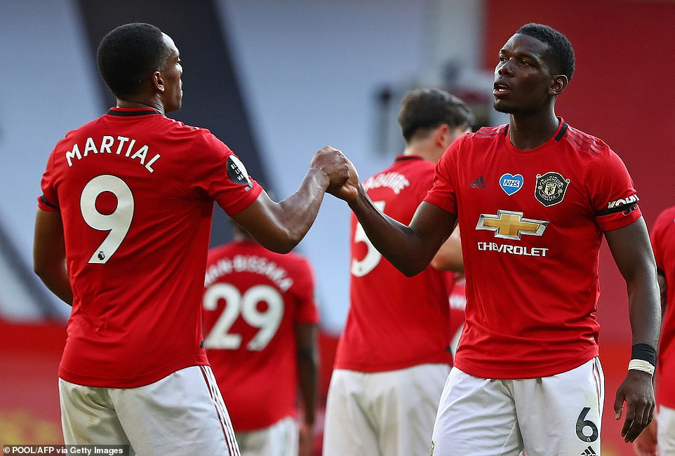 Martial is embraced by Paul Pogba after United eased to their first victory of the Premier League restart at Old Trafford