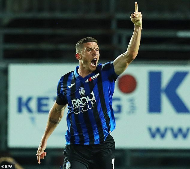 Robin Gosens roars with delight after giving Atalanta a way back into the match in the first half