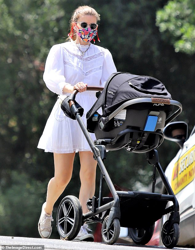 Kate Mara sported a stylish summery frock on a stroll with her 13-month-old daughter around her neighborhood in Los Angeles
