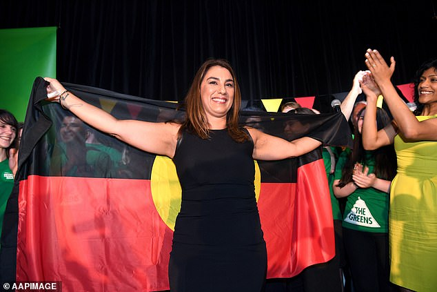 When Lidia Thorpe, raised in housing commission, left school at 14, she never expected to be a senator in the Australian Parliament. She is pictured in November 2017 holding an Aboriginal flag to herald her election as the first indigenous woman to the Victorian Parliament