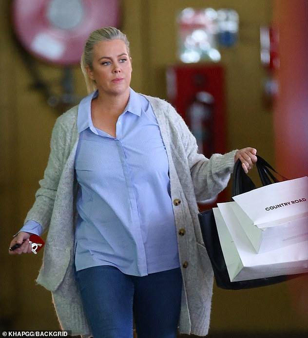 Shop til' you drop: Samantha Armytage's newly-engaged glow was hard to miss as she shopped up a storm Westfield Bondi Junction on Thursday