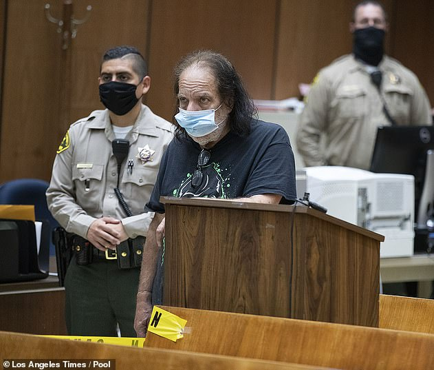 Porn star Ron Jeremy was on Tuesday charged with raping three women and sexually assaulting another. He is pictured appearing in the Clara Shortridge Foltz Criminal Justice Center in Los Angeles