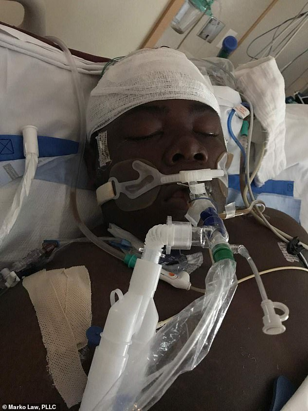 The teenager went into cardiac arrest as he was being restrained at the youth center and died in hospital two days later
