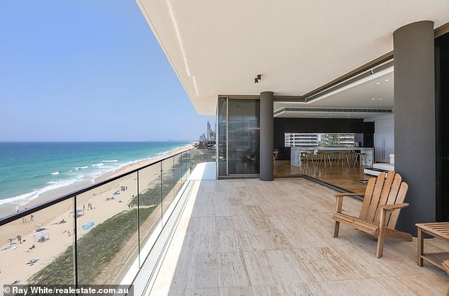 It features three ensuite bedrooms. two living areas and a beach view