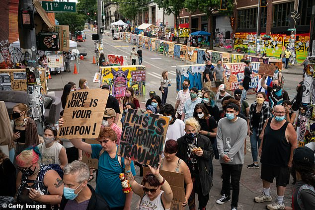 Pictured: Protesters march through the area known as the Capitol Hill Organized Protest (CHOP) on June 24, 2020 in Seattle, Washington