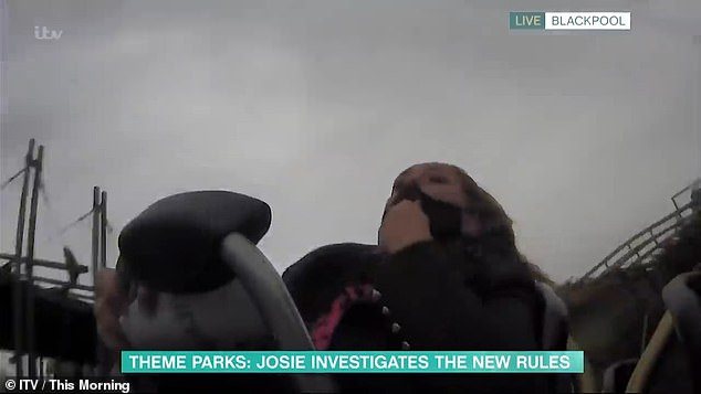 Hardcore: Josie was forced to ride some of the roller-coaster one-handedly as she struggled to put her mask back in place