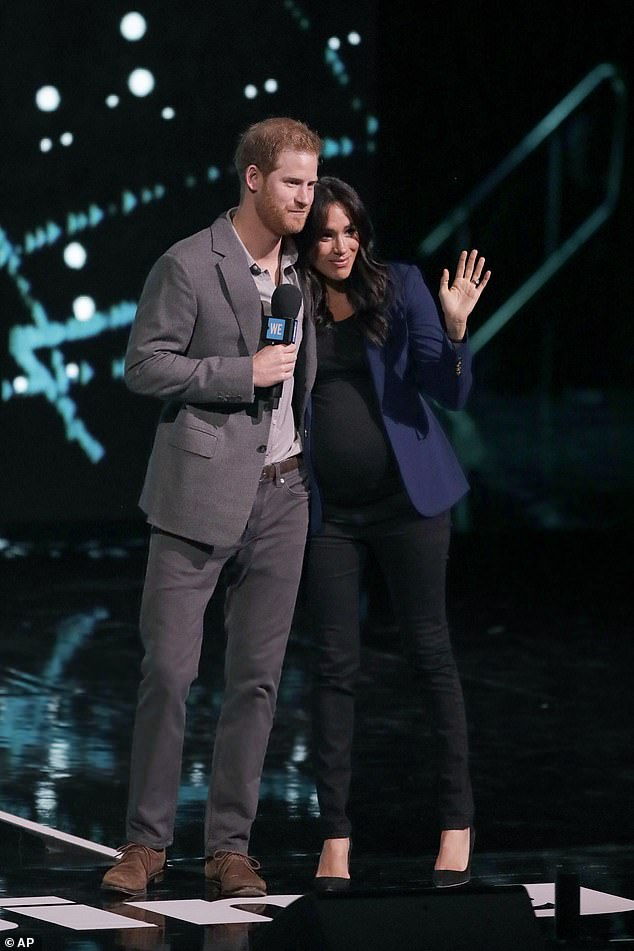 Meghan Markle and Prince Harry will have to share stories from their royal lives as part of their new £1 million a speech deal an expert has claimed. They are pictured giving a speech at Wembley Arena in 2019