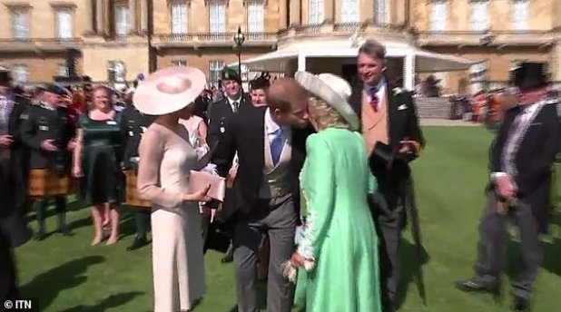 After a brief inaudible conversation with Prince Charles, Meghan and Harry said goodbye to him and Camilla before leaving the party.