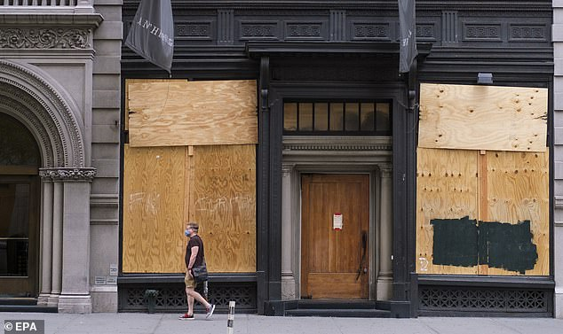 A man walks past a shuttered business in New York City on June 18. New U.S. Department of Labor numbers released today showed that another 1.5. million people filed for unemployment