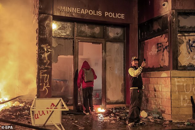 Over 1500 buildings were damaged during the unrest that followed the killing of George Floyd. The smoldering entrance to the burned Third Precinct pictured above on May 28