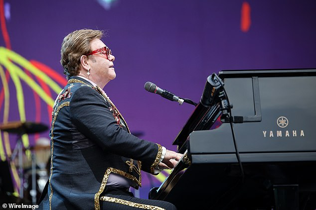 It wasn't until 1988 that Sir Elton announced he was openly gay - around the same time the couple divorced (pictured: Elton John performs at Mt Smart Stadium on February 16, 2020 in Auckland, New Zealand)