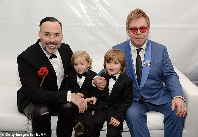 Left to right: David Furnish, Elijah Furnish-John, Zachary Furnish-John, and Sir Elton John attend the 23rd Annual Elton John AIDS Foundation Academy Awards Viewing Party on February 22, 2015 in Los Angeles, California