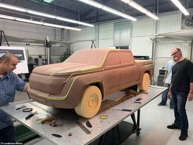 Designers are seen working with a clay model of the new Endurance pickup truck