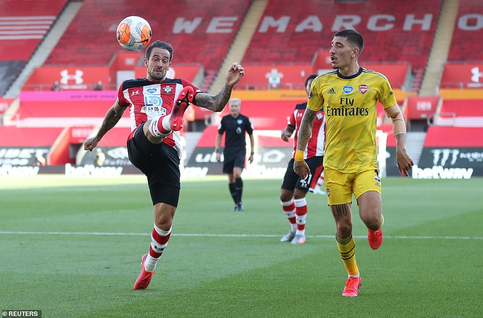 Southampton forward Danny Ings attempts to control the ball while under pressure from Arsenal defender Hector Bellerin