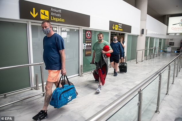 Tourists from Manchester arrive at Lanzarote airport in St. Bartolome, Lanzarote island, Canary Islands, Spain, 23 June 2020