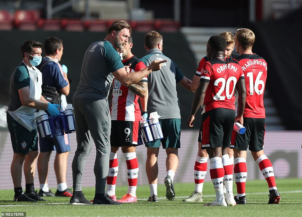 Southampton boss Ralph Hasenhuttl talks to his players during a drinks break in the first half of the Premier League clash