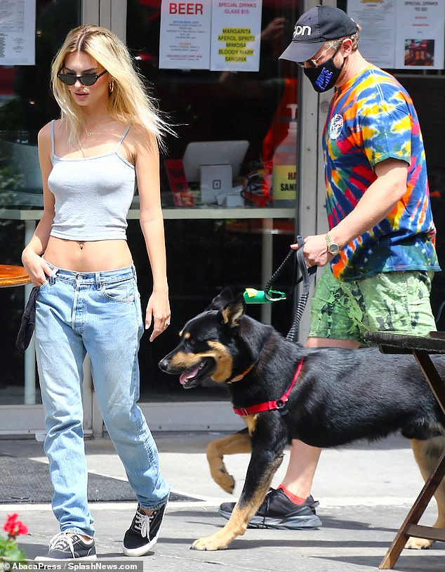 Having more fun? Blonde Emily Ratajkowski was pictured in New York on Thursday as she went for a walk without her mask, with husband is Sebastian Bear-McClard and their dog Columbo